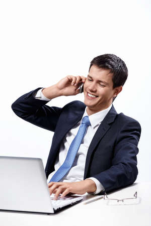 A man in a suit talking on the phone at your desk photo