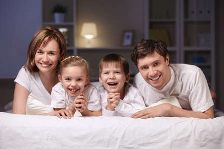 Families with children in bed at night Stock Photo - 8969758