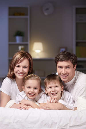 Families with children in bed at night Stock Photo - 8969757
