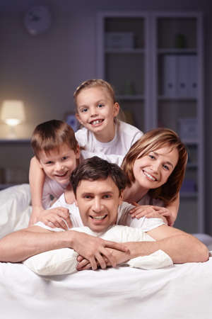 Families in bed at night at home photo