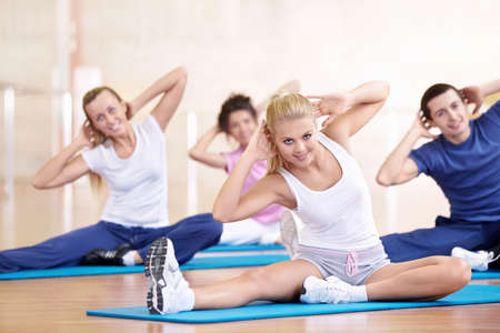 Attractive young people engaged in fitness Stock Photo - 8962119
