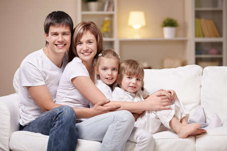 Family with children at home in the evening Stock Photo - 8969780