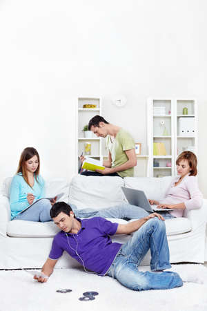 Attractive young people are engaged in a variety of activities at home photo