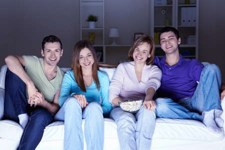home entertainment: Young attractive people watch movies at home