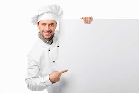 chef uniform: Cook showed to an empty board on a white background
