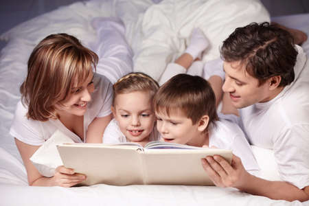 Parents with children are reading photo
