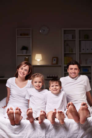 A happy family evening in the bedroom Stock Photo - 9075049