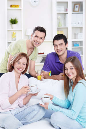Attractive young friends at home photo