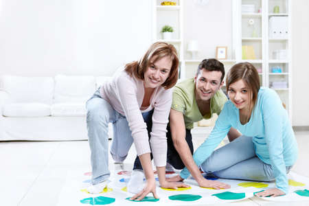 twister: Attractive young people play Twister Stock Photo