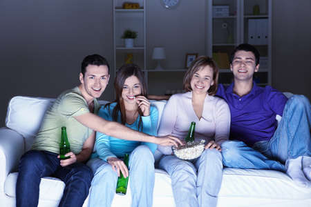 Young people watch TV at home photo