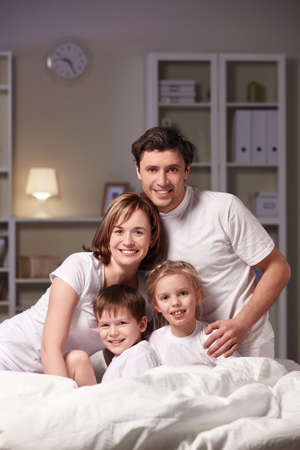 Families with children in the evening at home photo