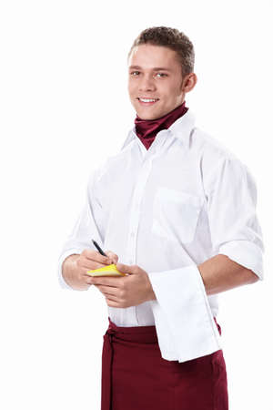 Attractive young waiter on a white background photo