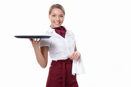 waitress: A young attractive waitress with a tray on a white background Stock Photo