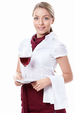 A young attractive waitress with a glass on a white background photo