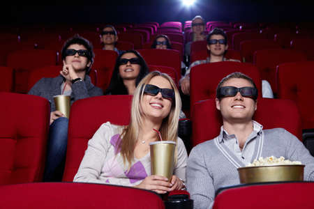 Young people in 3D glasses in cinema Stock Photo - 9326607