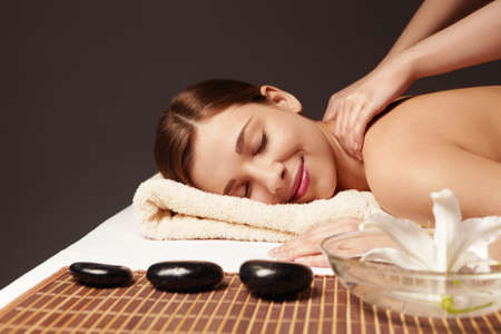 massage therapy: A young attractive girl make massage Stock Photo