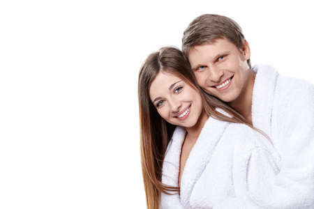 dressing gowns: Young attractive couple in dressing gowns on white background