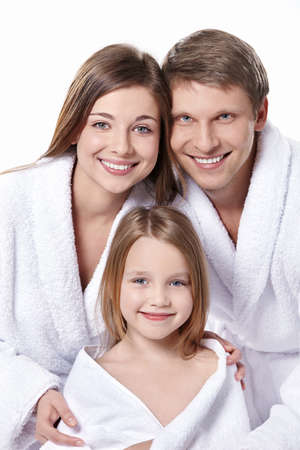bath robe: Young family in robes on a white background