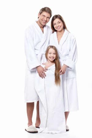 bathrobes: Familia joven en t�nicas sobre un fondo blanco