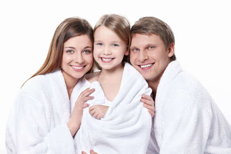 woman in towel: Family portrait in robes on a white background Stock Photo