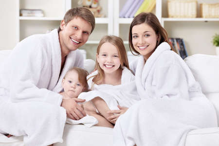 woman bathrobe: A family with two children at home