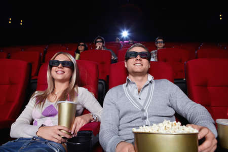Attractive people are watching movies in cinema photo