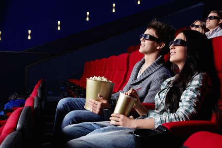watching movie: Young attractive people in the cinema
