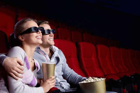Couple in love 3D glasses in cinema photo