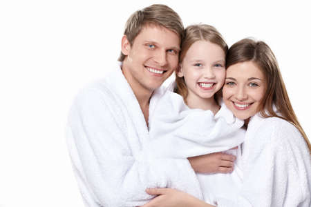 white robe: Family with a child in overalls on a white background