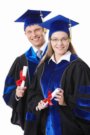 Two students with diplomas on a white background photo