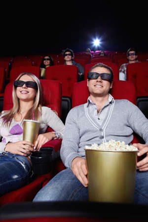 Young people watch movies in cinema photo