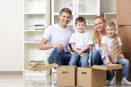 Families with kids and boxes indoors photo