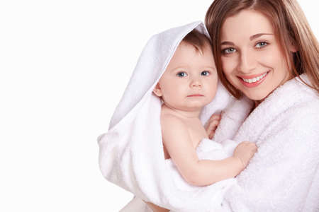 mom holding baby: Young mother with her baby in a white towel