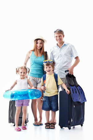luggage travel: A happy family with their suitcases on a white background Stock Photo