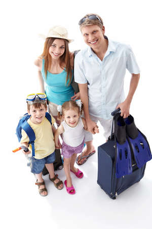 group travel: A happy family going on holiday on a white background Stock Photo