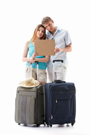 Tired couple with suitcases and an empty plate isolated photo