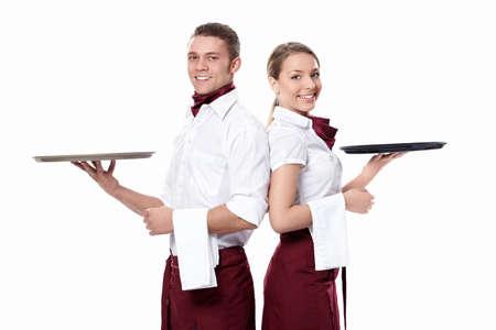 trays: Twee aantrekkelijke obers op een witte achtergrond Stockfoto