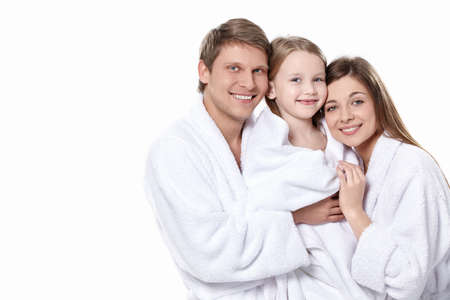 white robe: Happy family in the robes on a white background