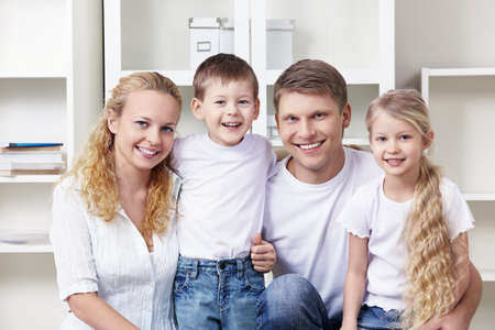 A happy family with two children at home photo