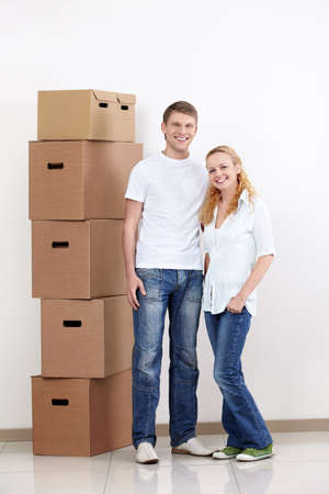 Young couple with boxes indoors Stock Photo - 9527995