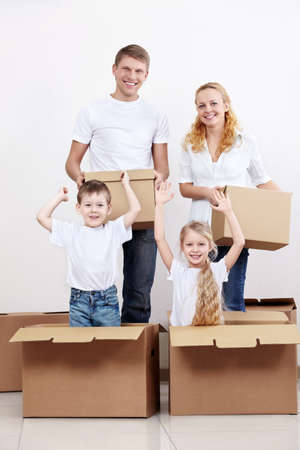Families with children jumped out of cardboard boxes photo