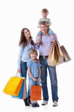 chicas comprando: Familias con ni�os con compras sobre fondo blanco Foto de archivo