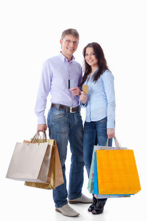 Young couple with credit cards and shopping on a white background Stock Photo - 9527973