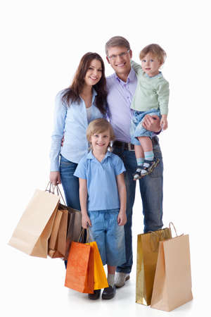Family with shopping on white background Stock Photo - 9527982