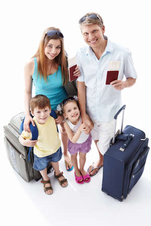 Families with passports and suitcases on a white background photo