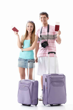 Smiling couple with passports and suitcases on a white background Stock Photo - 9527976
