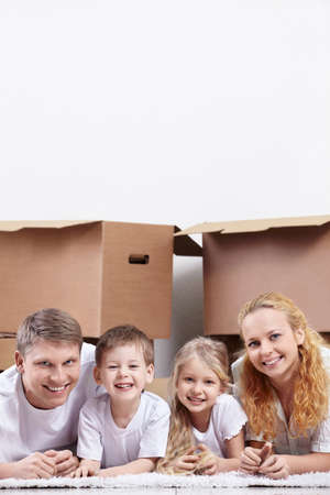 Smiling family on a background of cardboard boxes Stock Photo - 9602852