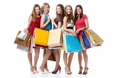 friendship women: Five attractive young women with shopping on white background Stock Photo