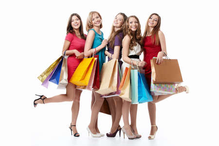 happy shopping: Happy attractive girl with shopping on white background Stock Photo