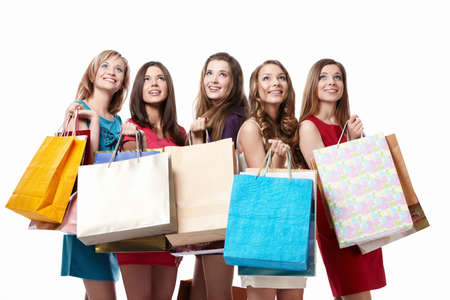 gift spending: Attractive girl with shopping looking up on white background